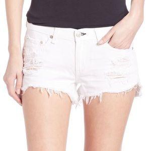 Rag & Bone white distressed shorts.